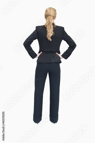 Businesswoman standing with back facing