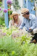 Couple having fun gardening