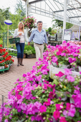 Couple searching for flowers outside the garden centre