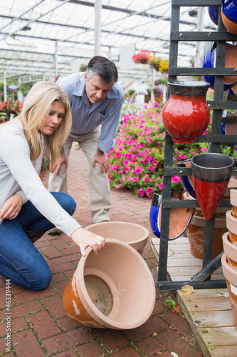 Couple looking at ceramic plant pot