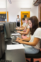 Students sitting at the computer concentrating