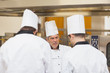 Angry head chef scolding employees