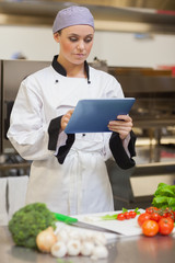 Chef consulting digital tablet