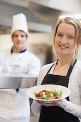 Waitress presenting a salad