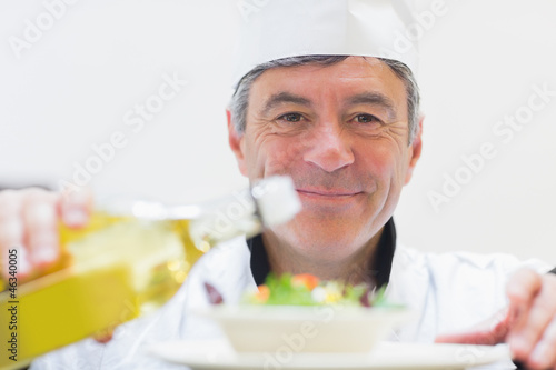 Chef dressing a salad