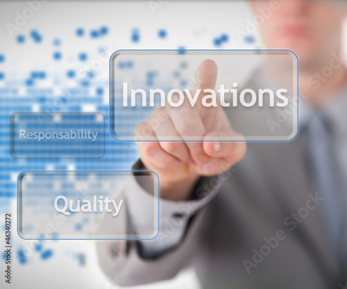 Businessman standing behind the word innovation