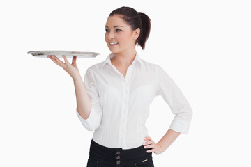 Waitress holding a tray and looking at it