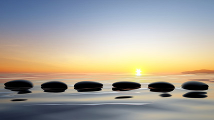 Scenic view of lake with Zen stones in the water