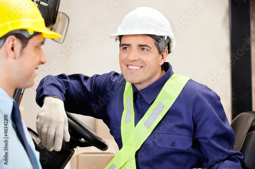 Forklift Driver Looking At Supervisor