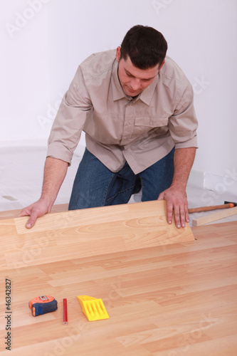 Man installing laminate flooring