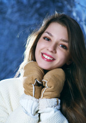 Portrait of happy young girl in gloves
