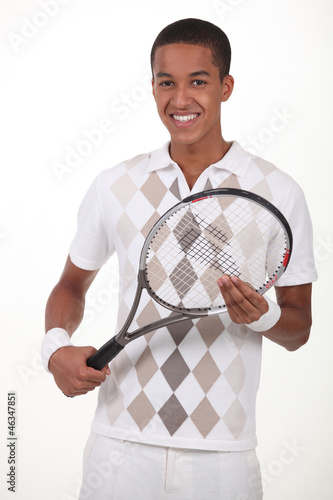 Man stood with tennis racket