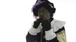 Zwarte Piet is eating a chocolate letter
