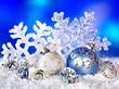 Christmas still life with snowflake and ball.