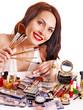Girl holding makeup brush.