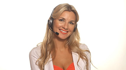 Pretty happy blond business woman smiling with headset