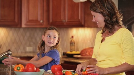 Caucasian family preparing dinner in kitchen
