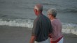 Senior Caucasian couple walking on beach