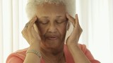 Senior African American woman with headache
