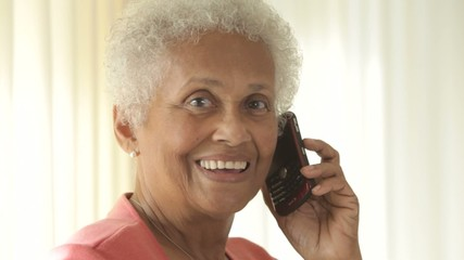 Senior African American woman talking on cell phone
