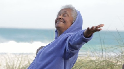 Senior African American woman at beach