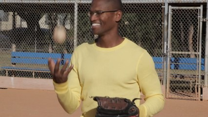 African American man playing baseball