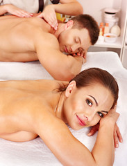 Couple relaxing in spa.