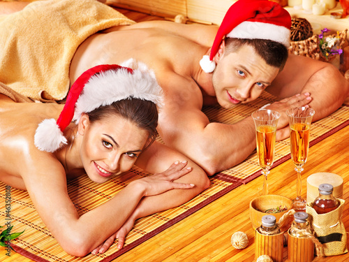 Man and woman relaxing in Xmas spa.