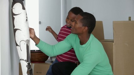 African American father with son and african sculpture