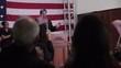 Hispanic political candidate giving speech at podium