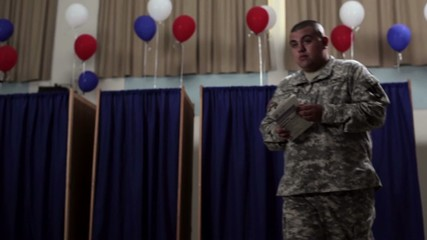 Hispanic soldier walking out from voting booth