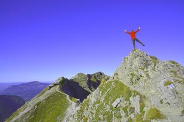 Balance auf Berggipfel