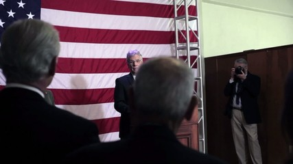 Caucasian political candidate giving speech at podium