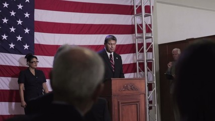 Hispanic political candidate giving speech at podium