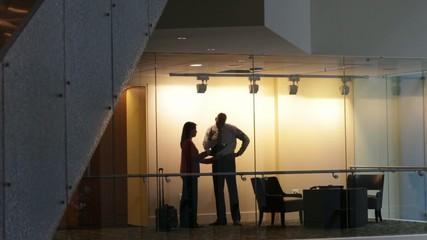 Business people having an informal standing meeting