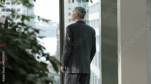 Caucasian businessman walking and answering cell phone