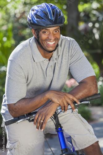 African American Man Riding Bike