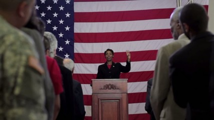 Political candidate addressing applauding crowd