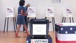 Senior man completing ballot at voting booth and placing it in ballot box