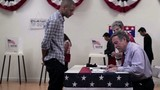 Voters registering to vote at polling place