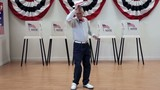 Senior man takes bow and dances in front of voting booths
