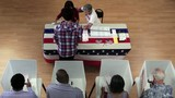 Overhead of voters in voting booths and registration table