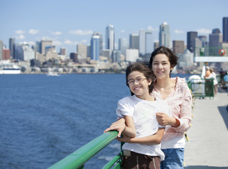 Two sisters on ferry deck with Seattle skyline in background