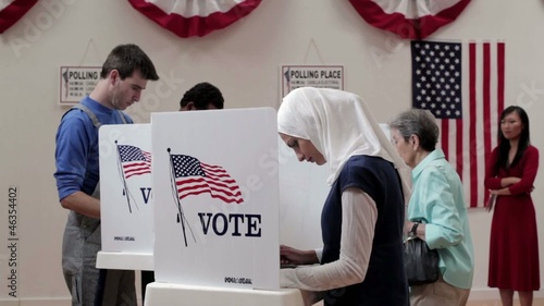 Group of voters voting at polling place