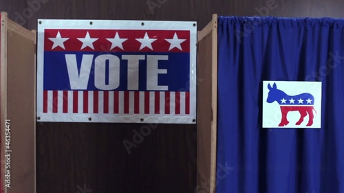 Voting booths with Democrat and Republican logo on curtains