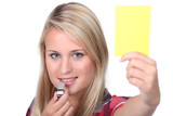 Girl showing the yellow card