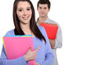 Boy and girl with folders