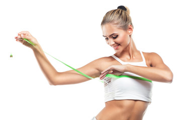 Woman in perfect shape with  green measure  doing  yoga poses. C