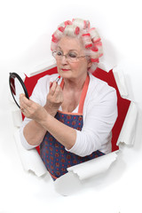 Senior woman making-up