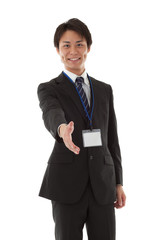 Young businessman for a handshake